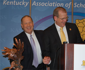 Superintendent of the Year recipient Randy Poe of Boone County Schools, right, shares a laugh with Wayne Young, executive director of the Kentucky Association of School Administrators, who presented him with the award.