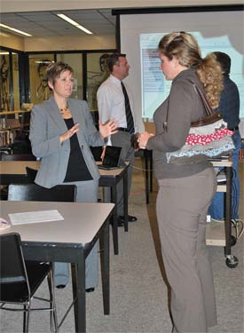 Angela Shouse, right, a parent member of the school council at Westridge Elementary School, asks questions of Melissa Wainwright, director of elementary and middle school curriculum.