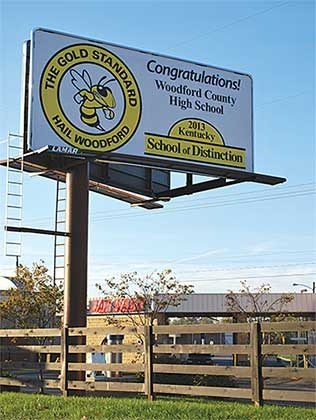 The colorful billboard in Woodford County is one of two the district used to congratulate Woodford County High School on its achievement in the 2013 assessment and accountability scores. This one is prominently located at a high-traffic intersection in Versailles, while the other is attracting attention in front of McDonald's. The district paid for the billboards with funds set aside for student honors and awards.