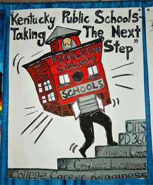"Pendleton County Schools' banner was one of more than 130 that lined the hallways and the ballroom at the Galt House. School districts are encouraged each year to have their students create banners illustrating the conference theme. This year's was, ""Kentucky Public Schools: Taking the Next Step."""