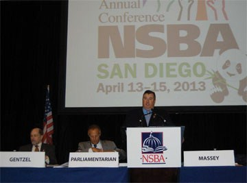 Boone County board member Ed Massey presides at the NSBA Delegate Assembly as one of the final acts of his year as national president. Massey was honored for his service by the Kentucky delegates who included Ramona Malone of Newport Independent, Mike Wilson of Warren County, and Associate Executive Director David Baird, as well as Narramore and Kennedy.