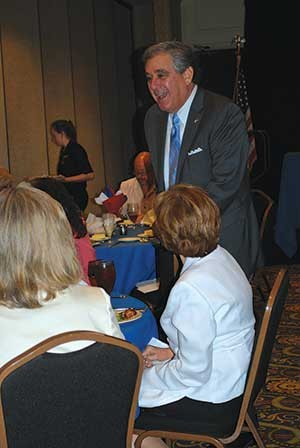 Lt. Gov. Jerry Abramson, shown at right talking to a group from Jefferson County, addressed the entire meeting, focusing on tax reform.  The event also included a panel with representatives of the Kentucky Education Action Team, a coalition of state education groups, to discuss and develop budget priorities.