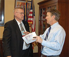 Sen. Rand Paul of Bowling Green discusses student academic statistics with KSBA President Durward Narramore of Jenkins Independent. Also attending this meeting were John Lackey of Madison County, Debbie Wesslund of Jefferson County and Ed Massey of Boone County, along with Duncan and Kennedy.