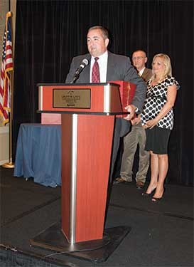 "Barren County Schools Superintendent Bo Matthews, left, received the Kids First Award for a superintendent for his advocacy activities on behalf of K-12 education. Matthews was singled out in particular for his work on the state Juvenile Justice Task Force, where he represented public education, during its work during the 2013 interim session of the legislature. A bill reforming the state's juvenile justice system was approved during the 2014 General Assembly, and Matthews is credited with ensuring it was revised to reduce the negative impact on schools. Without Matthews' input, his nomination for the award said, the legislation ""would have been extremely detrimental to public education."""