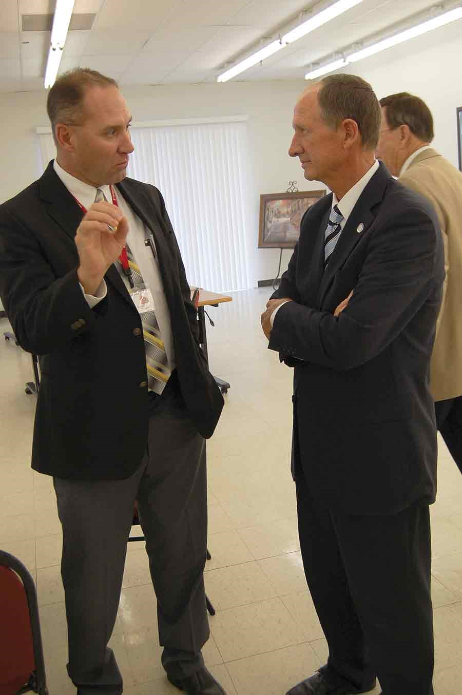 First-year Mayfield Independent Schools Superintendent Joe Henderson (left) makes a point in this one-on-one chat with Rep. Richard Heath (R-Mayfield). Echoing statements by his colleagues, Heath noted there will be considerable competition for any new funding when the legislature crafts the state budget for the 2016-18 biennium.