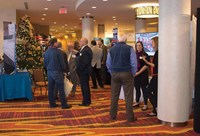Attendees check out vendor exhibits between clinic sessions. Twenty companies that provide services to Kentucky school districts set up booths for the event.