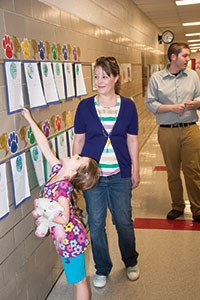 First-grader Reagan Boone-Menke points out some of her work about Earth Day to her mother, Rachel Boone. Ludlow Schools Superintendent Mike Borders said one goal of the evening was to get younger students and their parents into the school to see the other artistic studies opportunities available in the upper grades.