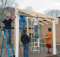 Members of the ATC carpentry class – (from left) Avory Lowe, Deklan Osborne, teacher Mike Jude, Cody Bowen and Kyle Bowen – employ geometrical calculations, estimations of stress and weather hardiness of materials in building the two gazebos. They even learn about logistics – one of the gazebos is being built in sections as it runs 24 feet wide but must travel over a 20-foot bridge to get to its eventual home.
