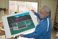 Carpentry teacher Mike Jude displays an artist's rendering of the design for the final product. Jude obtained a $25,000 Skills USA Community Services grant plus assistance from the area Lowes Home Improvement store to support the project.