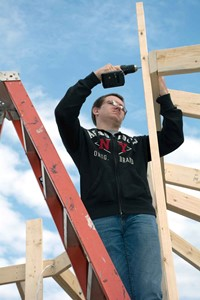 Deklan Osborne anchors the top of one 15-foot tower bridge for the gazebo going up next to the ATC. In addition to the carpentry students, electrical class members are wiring both facilities so students can use laptops and other electrical devices at each site. Eventually community members will be able to use the gazebos for special events when school is not in session.