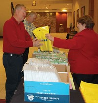 More than 300 school board members and superintendents attended this year's Winter Symposium, with a large segment of the participants being newly elected local board members. Whatever their status, they were aided in registration by KSBA Board Team Development/Legal Training Service executive assistant Tammie Conatser.