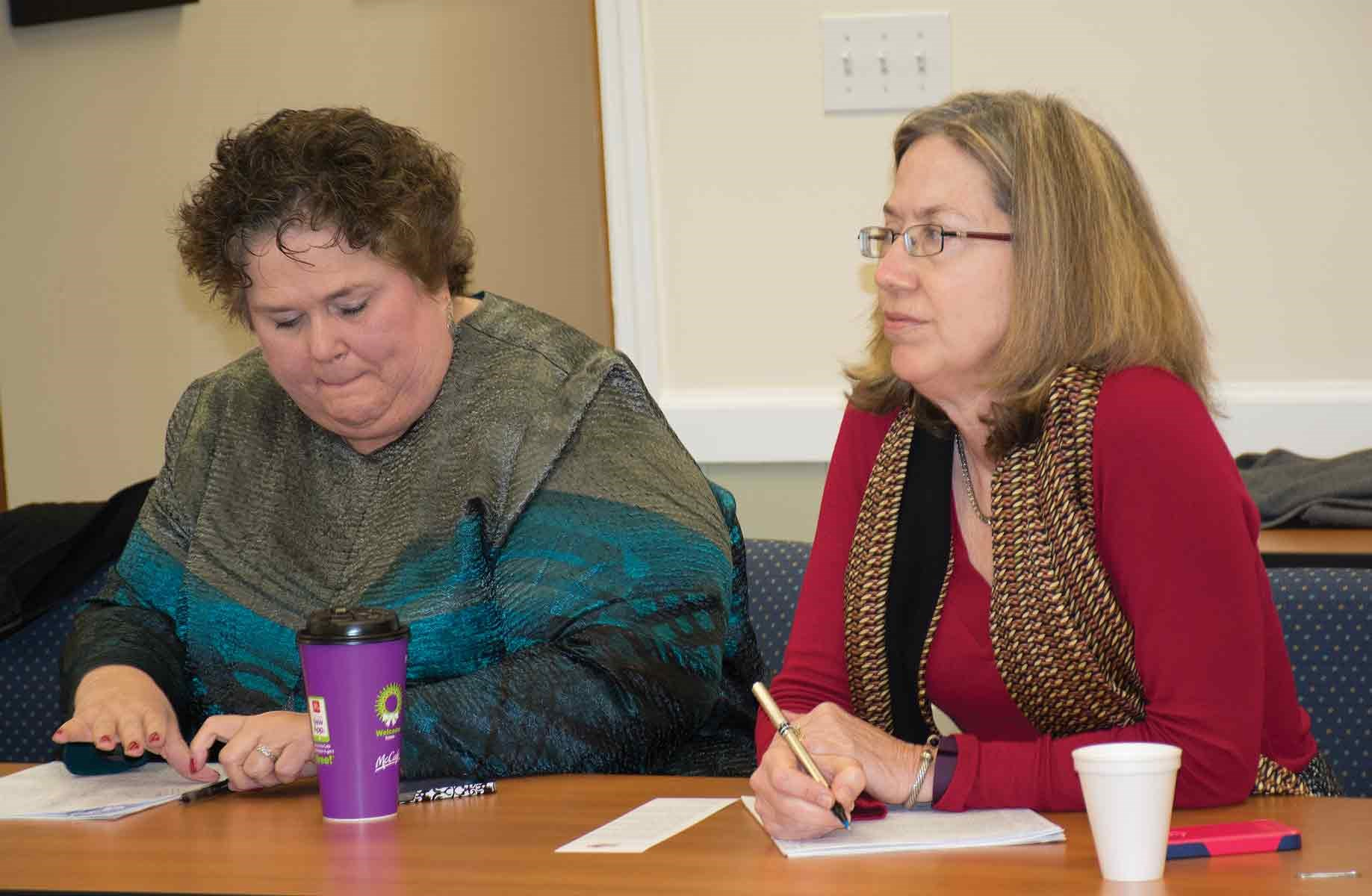 Kentucky Education Association Executive Director Mary Ann Blankenship (left) and Lynne Slone, legal counsel for the Kentucky Association of School Councils, take notes as OSBA's director of legislative services Damon Asbury and Sara Clark, the association's director of legal services, detail recent reform law passed to address numerous problems involving charter schools operating in Ohio.