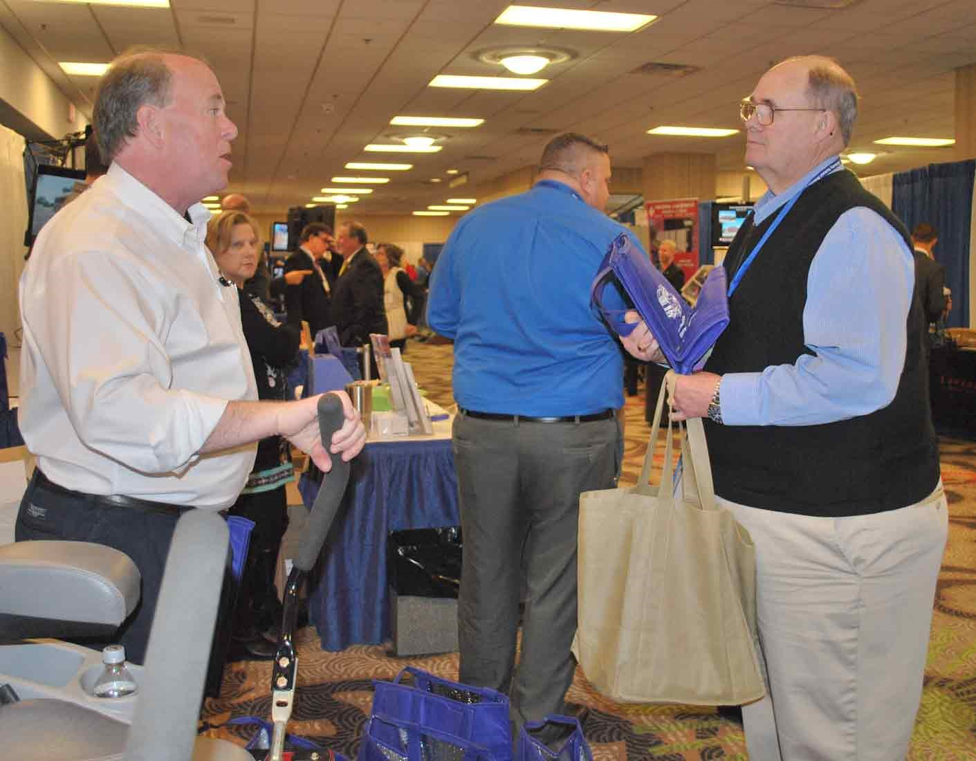 Jessamine County board member Gene Peel, right, talks with Tom Underwood with the Kentucky Propane Education and Research Council at the group's Trade Show booth.