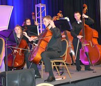 The Fort Thomas Highlands High School Chamber Orchestra performs during the conference's opening session Friday.