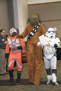 Just like a regular school spelling bee, a formal list of words is used by the pronouncer and judges. For this event, a special squad of Star Wars characters guarded and delivered the binder at the opening of the event, which has raised more than $93,000 to boost after-school services for special needs students.
