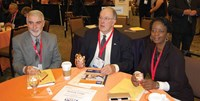 l-r, President elect David Webster of Simpson County, President Allen Kennedy of Hancock County and Director at Large Ramona Malone of Newport Independent used electronic clickers to cast their votes during the Delegate Assembly.