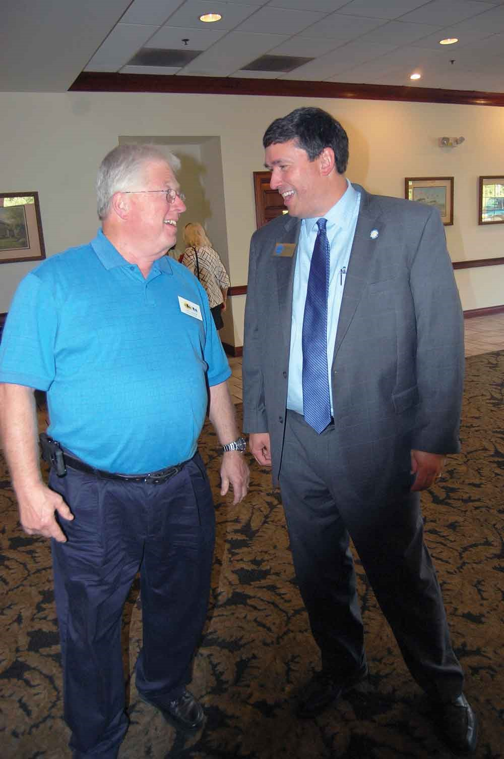 Among the dignitaries dropping in at this year's meetings was Kentucky Education Commissioner Stephen Pruitt (right) who shared a moment at the Fifth Region meeting in Shelby County with his local school board member, Larry Dodson of the Oldham County Board of Education. Dodson, who is running for another term in office, took the opportunity to ask Pruitt for his vote.