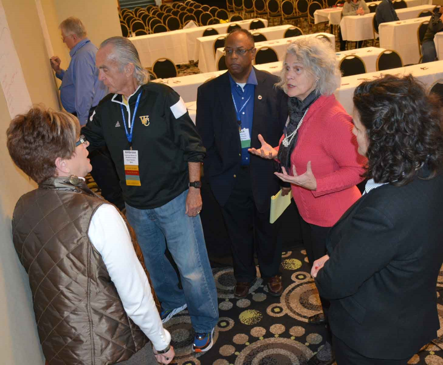 Mimi Becker, the executive director of the Arts Commission of Danville/Boyle County, interacts with attendees during a clinic session at the conference.