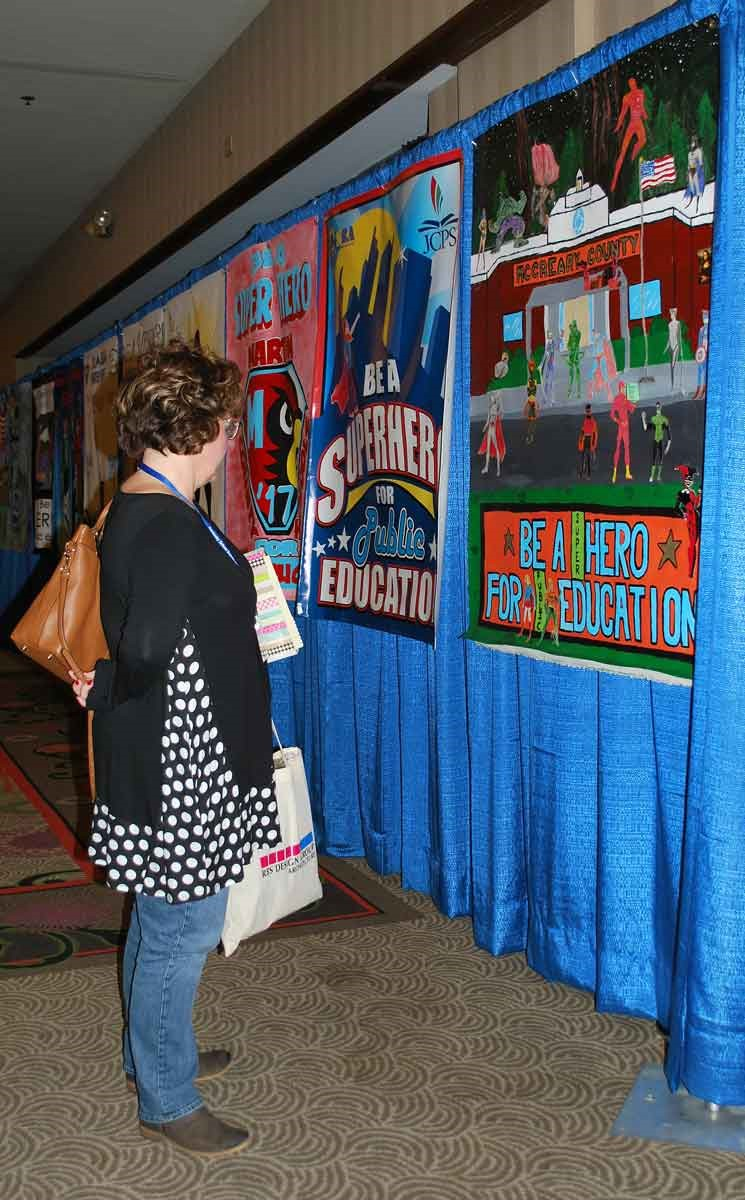 Students seemed especially inspired by this year's superhero conference theme. KSBA received student-designed banners from more than 130 districts for display during the event.