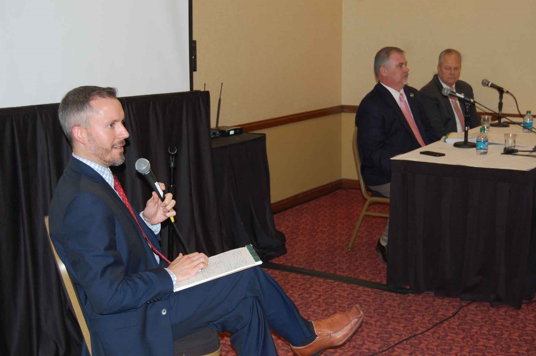"Not surprisingly, the clinic session focused on the 2017 legislative session – then at its halfway point – was lively, moderated by KSBA Governmental Relations Director Eric Kennedy (foreground), with panelists (left to right) House Education Committee Chairman John ""Bam"" Carney and his Senate counterpart, Mike Wilson."