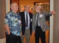 New KSBA President David Webster, right, talks with outgoing President Allen Kennedy, center, and President-Elect Ronnie Holmes during the conference.