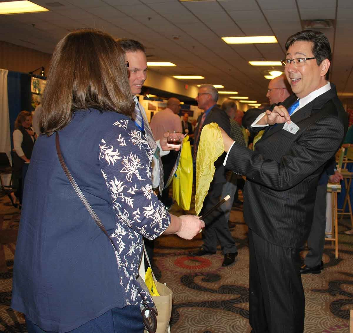 Magician David Hira was back, entertaining board members and others who visited RossTarrant Architects' booth at the Trade Show.