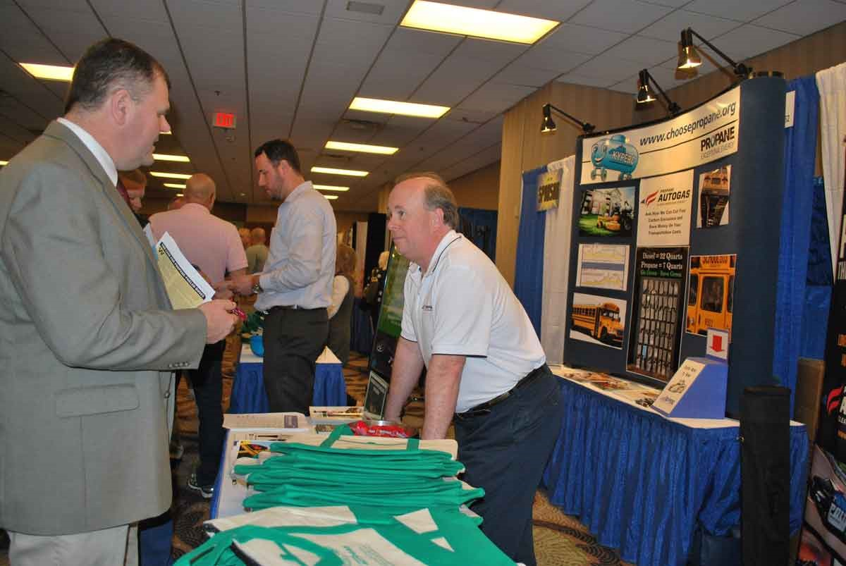 Tom Underwood, right, executive director of the Kentucky Propane Education & Research Council, talks to a conference attendee at the company's Trade Show booth.