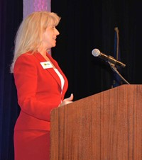 KSBA Associate Executive Director welcomes attendees during the opening session of the annual conference.