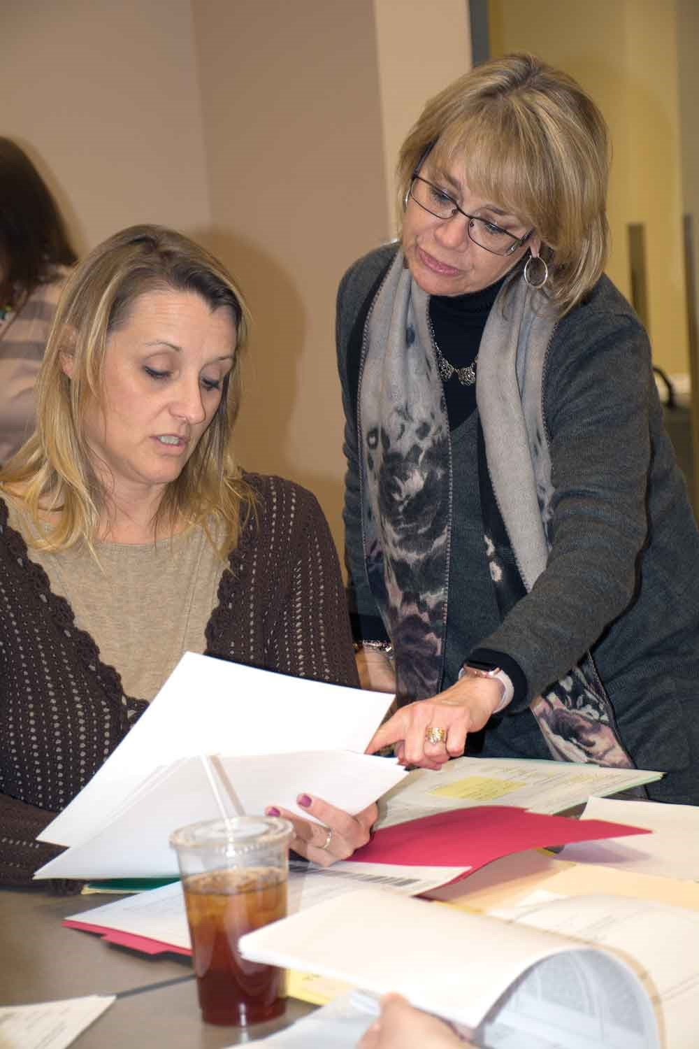 Tumolo-Wash works with Oldham County Schools' speech language pathologist Lori Pyle during a training on meeting Medicaid records-keeping rules. KSBA provides technical guidance for directors of special education and support staff who must file the reports within those rules for districts to recoup their expenses.