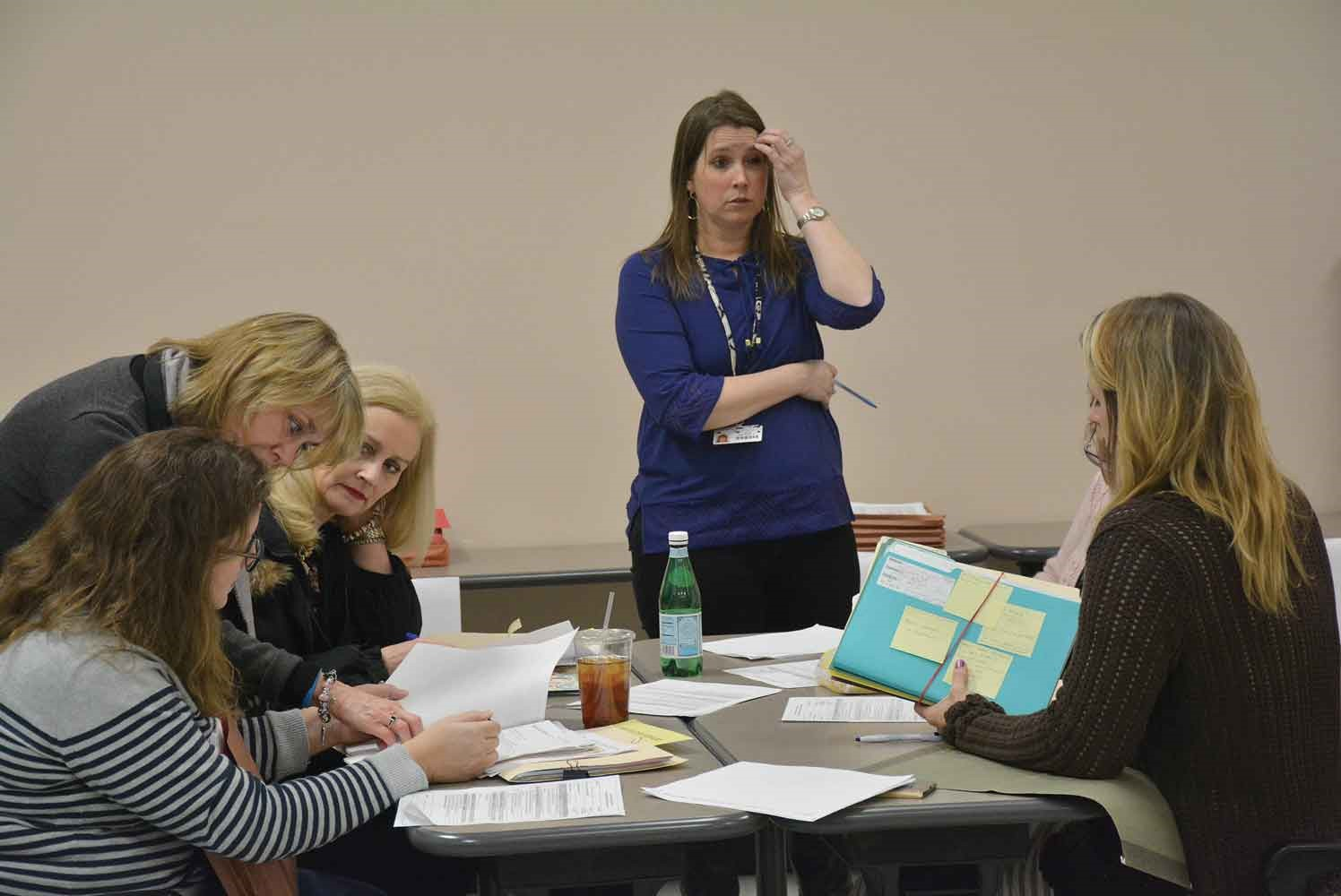 "In a ""peer review"" session led by Tumolo-Wash, Rachael Rawlings, another Oldham County Schools' speech language pathologist, raises a point with members of her training team. Peer reviews require school personnel with similar roles to examine documents to ensure correct coding of speech, occupational, physical, mental health and nursing services to students."