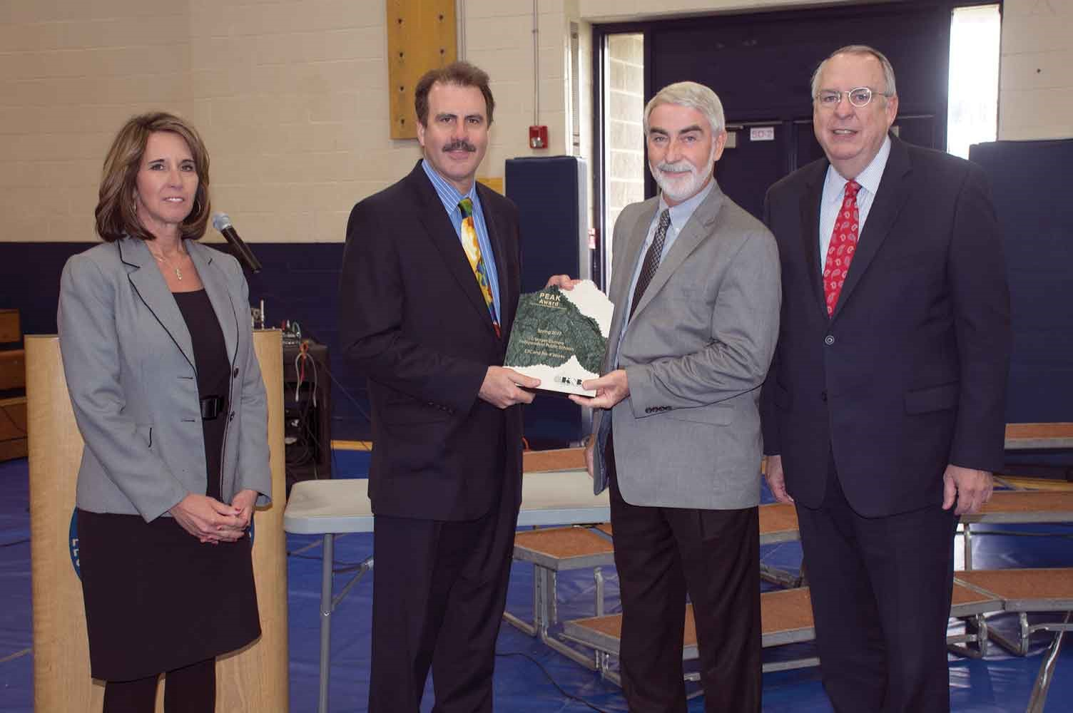 KSBA President David Webster, second from right, and KSBA Executive Director Mike Armstrong, far right, present the 2017 Spring PEAK Award to Erlanger-Elsmere School Board Chairman Tom Luken and Superintendent Dr. Kathy Burkhardt.
