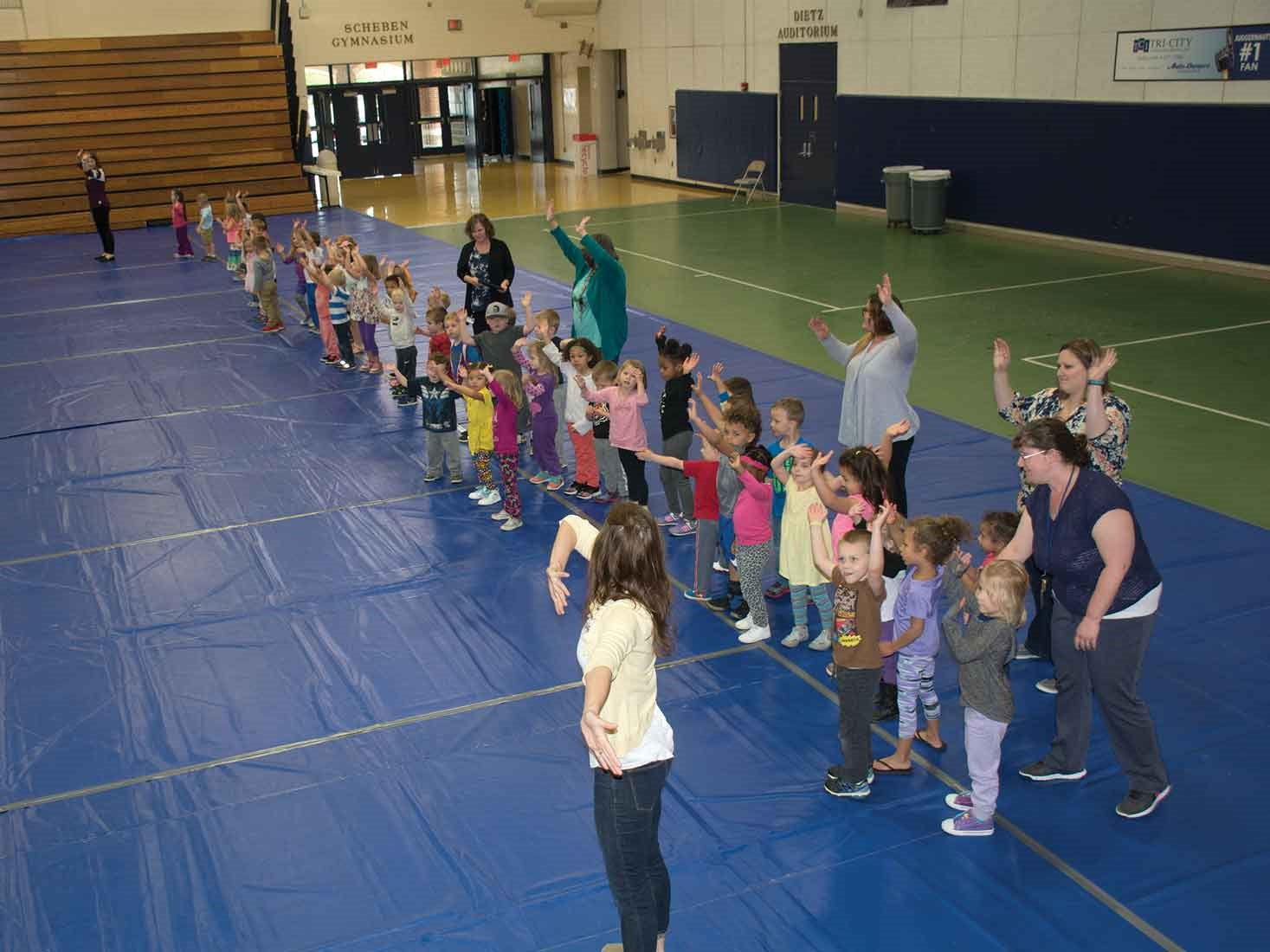 Students in the district's Early Learning Center performed a dance during the PEAK Award ceremony at Lloyd Memorial High School's Scheben Gymnasium.