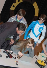 Elizabeth Gilbert, a junior at Wolfe County High School, synchronizes software built into the drone at her right with corresponding command technology to direct the unit's flight. KVEC is building a modular classroom next to its Hazard headquarters initially for use by students interested in drone technology with an eventual plan to relocate the facility to the site of the proposed drone port as a training center for scientists and students.