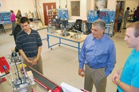 Robotics program students Jacob Harrison (left) and Leo Wiley show State Rep. Steve Riley (R-Glasgow