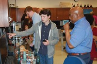 Local engineer Eric  Crawford of Akebono Brake Corp. (right) watches as principles in engineering st
