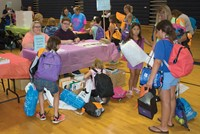 After getting clothes at the yard sale and the backpack with school supplies, families went to the gymnasium where about two dozen organizations, including the Trimble County public library, were on hand to provide information to parents.
