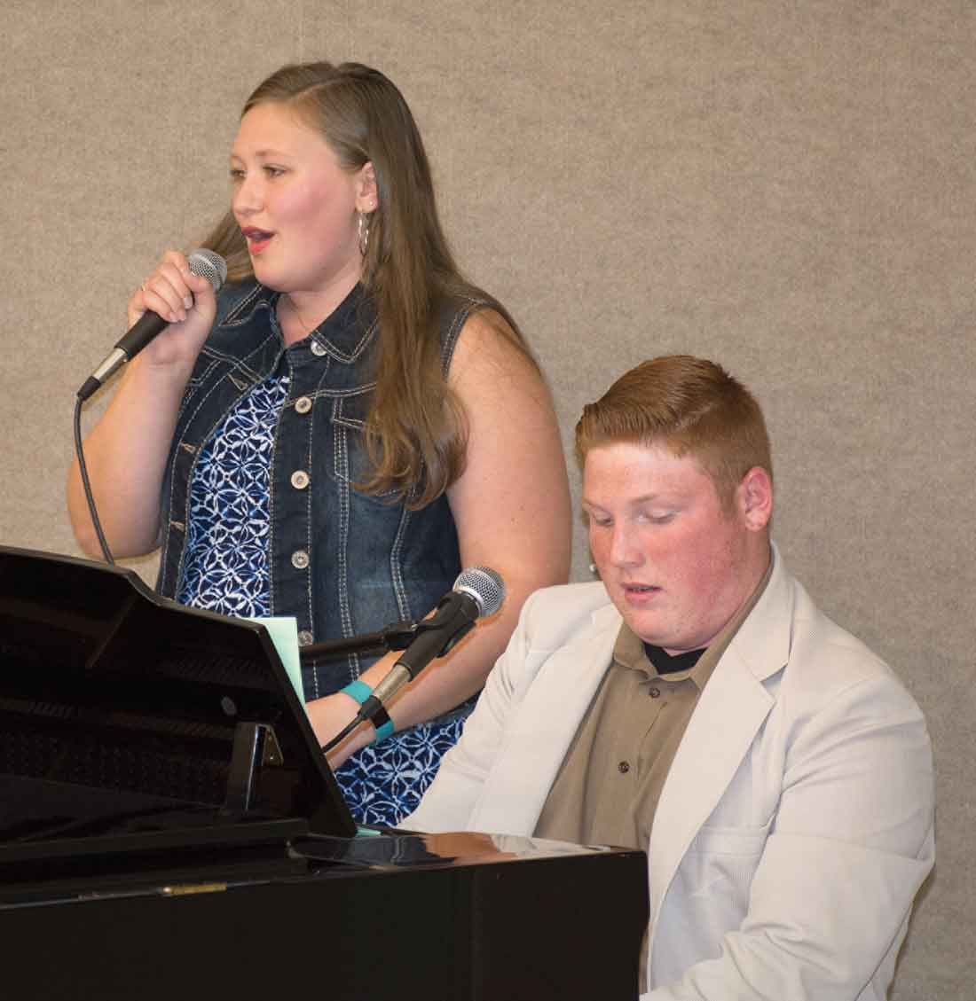 At the First Region meeting, Hickman County High School students Hannah Carroll and Ryker Cagle sing