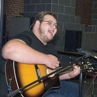 At the Upper Kentucky River meeting in early September, Lee County student Todd Fultz plays a guitar