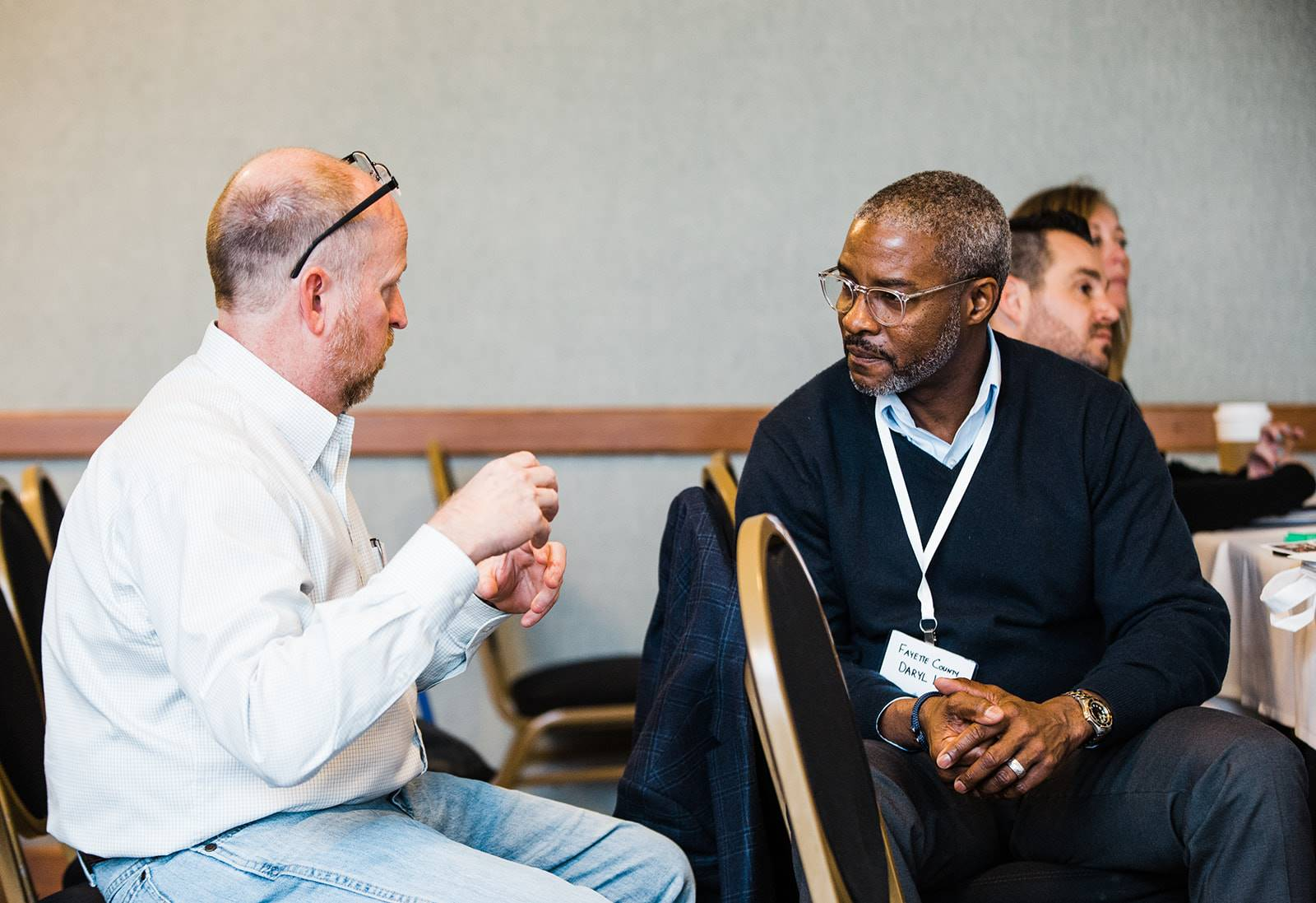 Two conference attendees interacting.