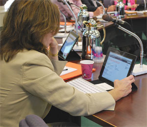 Board member Mary Gwen Wheeler of Louisville looks at an item on the board's meeting agenda for later that morning.