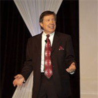 Conference speaker puts humorous spin on the power of positive thinking