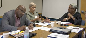 Christian County school board member Susan Hayes makes a comment as KSBA's new Equity Cadre holds its first meeting; at left is EKU assistant professor Roger Cleveland and at right is Jacqueline Pope-Tarrence, the group's chair.