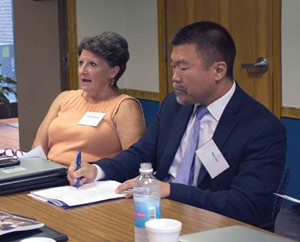 Frankfort Independent school board member Jina Greathouse  participates in the discussion at the KSBA Equity Cadre's first meeting as Stephen Chi listens.