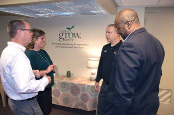 From left, Dayton Ind. Superintendent Jay Brewer, NKCES Executive Director Amy Razor, Bellevue Ind. Superintendent Robb Smith and Covington Ind. Superintendent Alvin Garrison talk after the co-op's September meeting.