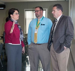 State Rep. Sannie Overly of Paris talks with Rowan County Schools officials Glen Teager, finance officer (center), and Assistant Superintendent John Maxey following the Legislative Breakfast.