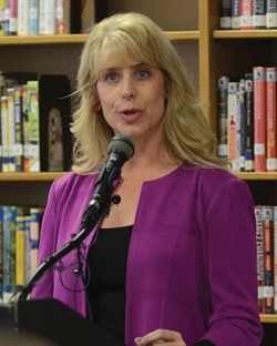 KSBA Executive Director Kerri Schelling speaks about the Shared Responsibility Plan at a press conference held Nov. 6 at Woodford County High School.