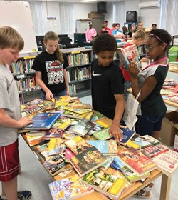 "Southgate Independent students look at books during the district's ""Big Bag of Books"" event. (Photo courtesy of Southgate Independent Schools)"