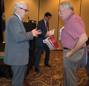 David Wickersham, left, who heads the Office of Education Accountability, talks with Harrison County board member Gary Dearborn following his clinic session at Summer Leadership Institute.