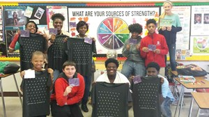 "Health education and Sources of Strength Club students at Butler Traditional High School hold up ""thank you"" cards that identify the positive adult mentors and friends in their life as part of a Sources of Strength event. (Photo: Butler Traditional HS)"