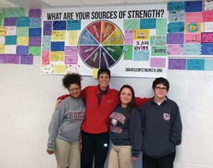 A few of the 50 Sources of Strength peer leaders at Butler Traditional High School pose with health teacher Mary Wurst last school year. (Photos courtesy of Butler Traditional High School)